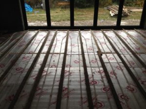 110m² underfloor heating installation in-between joists at Leeds